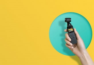 Image contains DJI Osmo Pocket Gimbal 4k Camera in hands