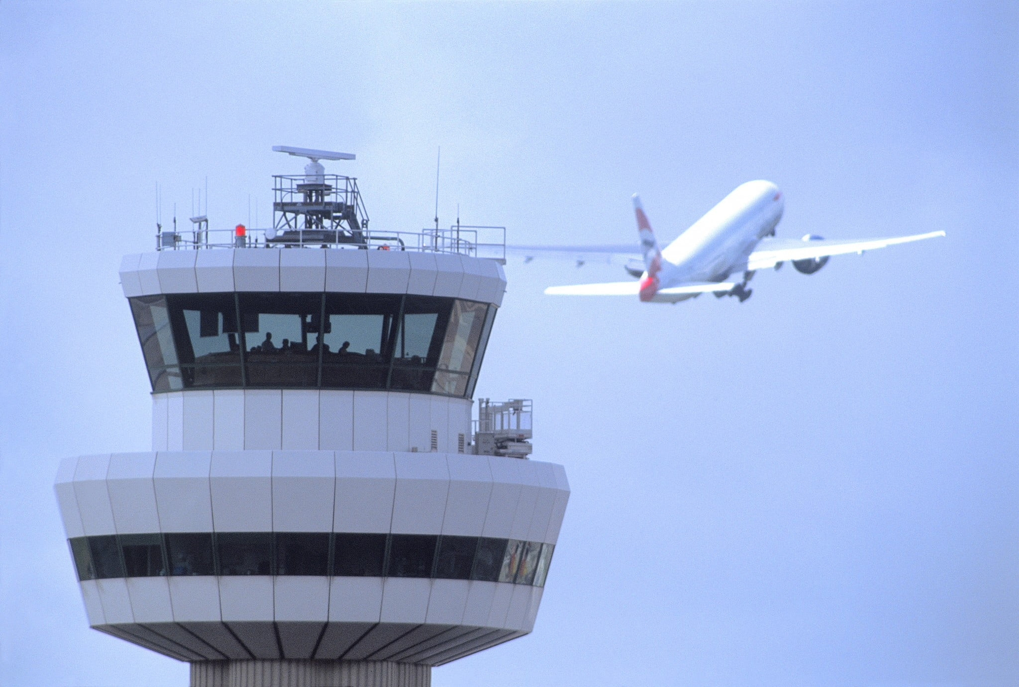 Gatwick Airport, Control tower with aircraft in flight in background, DP, 19 August 2004, (CGA857)
