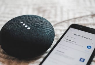 An image contains Google Home Mini with an Android phone