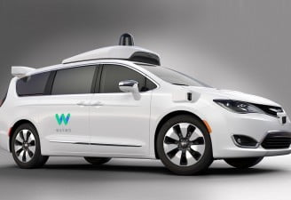 Image of Waymo self driving cars white