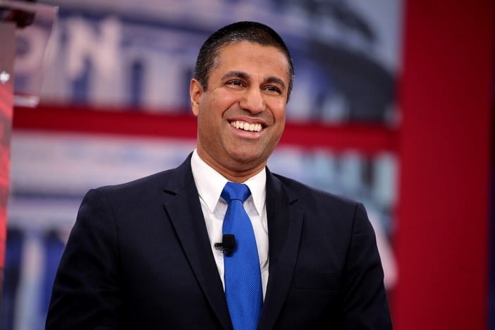 A portrait of Ajit Pai smiling, congress fails to save net neutrality