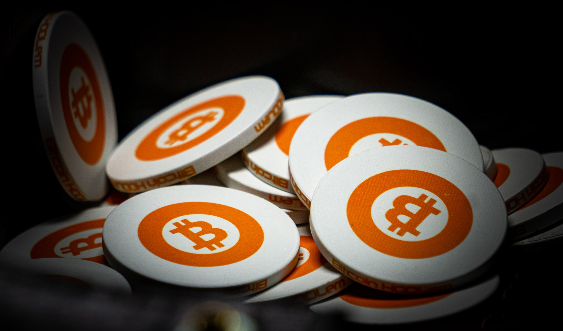 An image of white and orange bitcoins