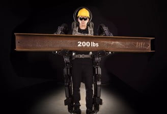 human wearing sarcos exoskeleton suit