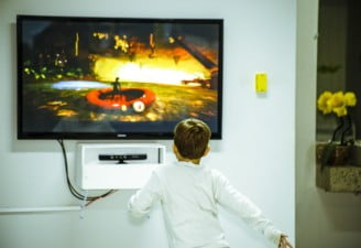 A kid watching TV