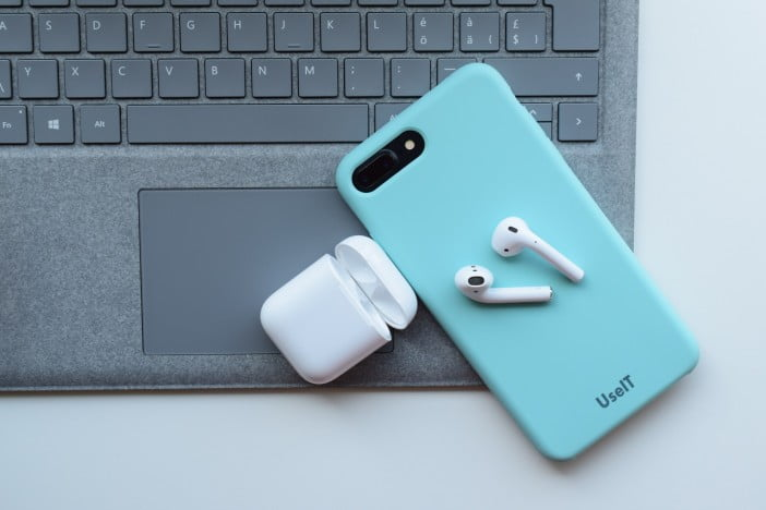 AirPods on a laptop with iPhone 8 plus