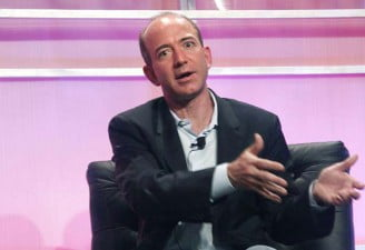 Jeff Bezos talking to a media personal during an interview