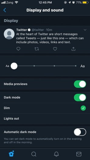 A screenshot of Twitter app with standard bluish dark mode enabled
