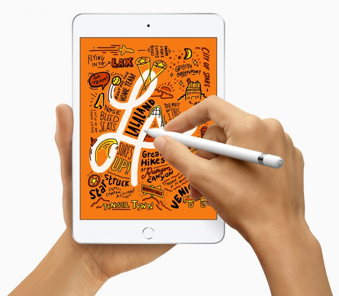 A person doodling on iPad Mini with Apple Pencil