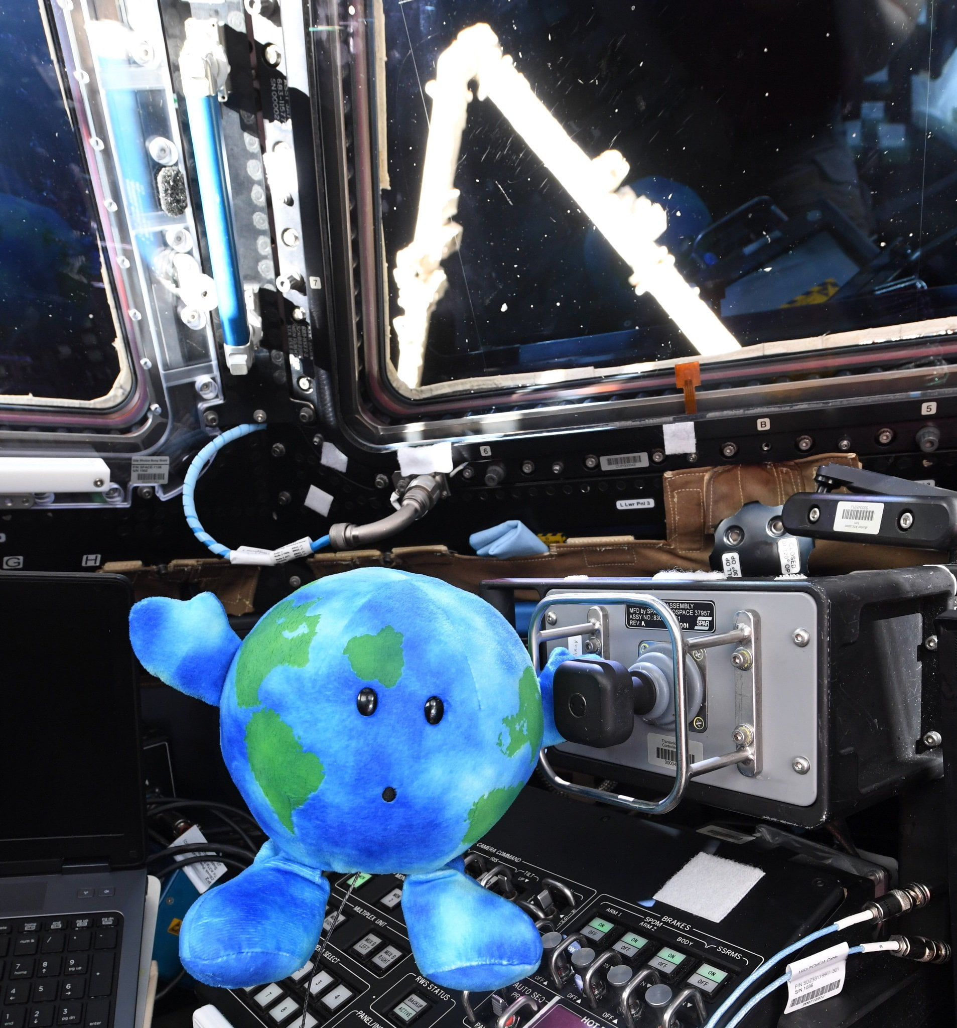 A photo of toy earth aka Astro Annimal in Space