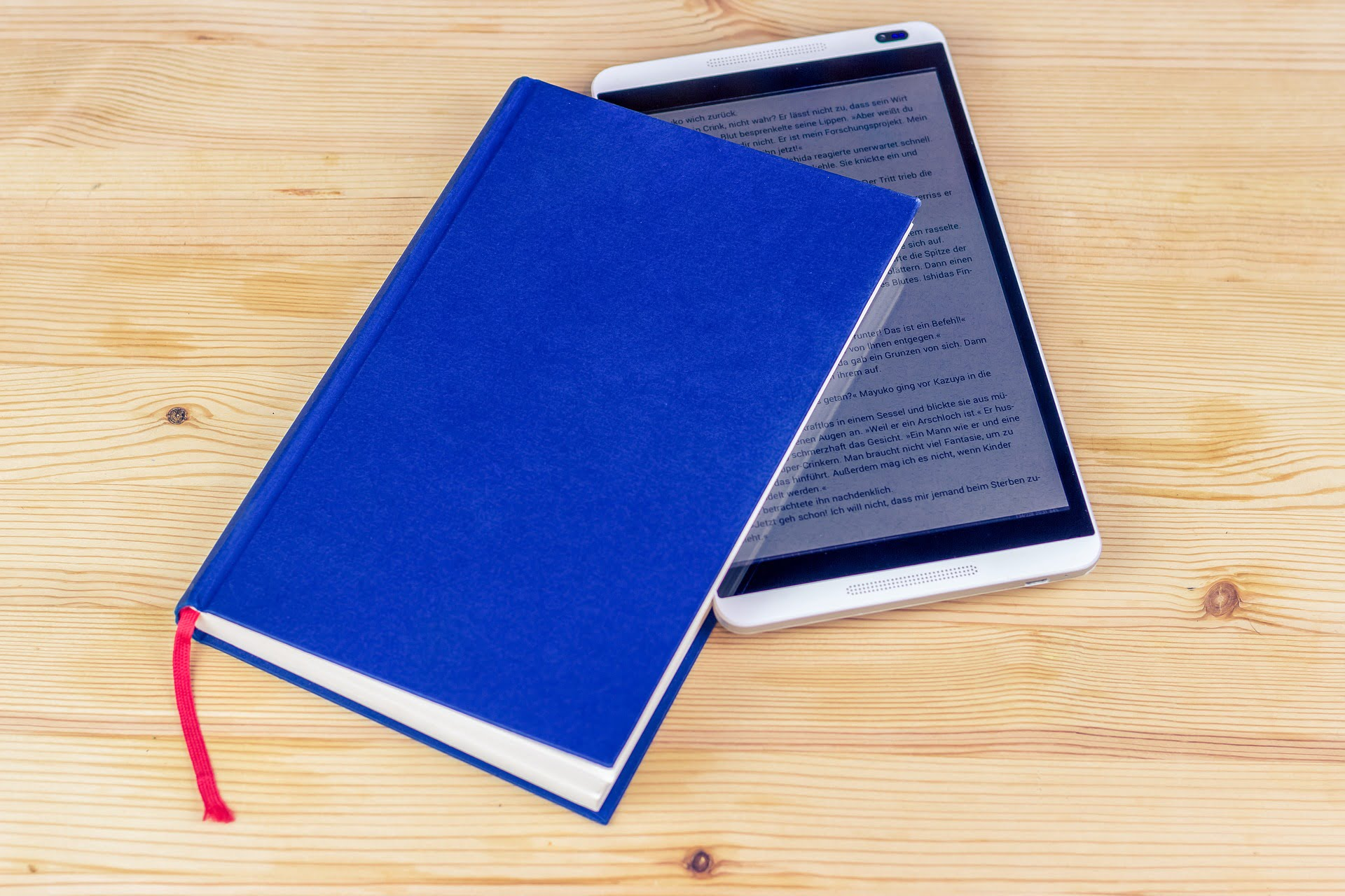 A photo of the tablet with an ebook opened, placed inside a blue book
