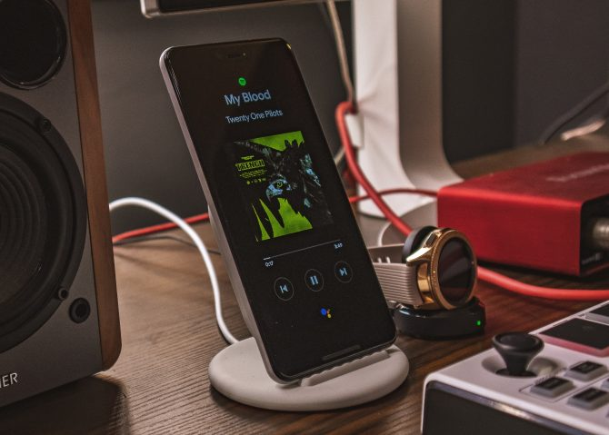 A photo of Google Pixel 3 Xl showing Spotify running on a bedside table