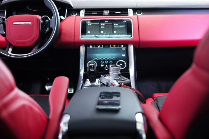 A photo of smart car dashboard showing inside of a luxury car