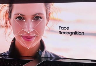 A picture of presentation screen showing a face with face recognition feature at Samsung event
