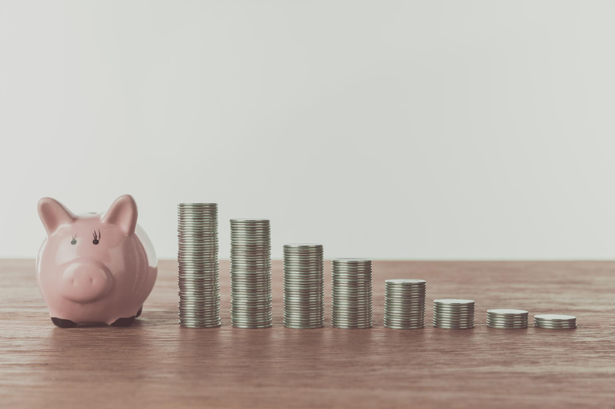 A photo of Piggy bank and coins