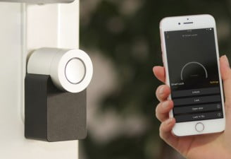 A photo of iPhone used with smart home security appliance