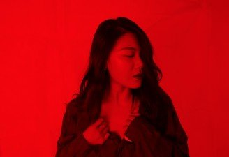 A red tone photo of a girl with anxiety