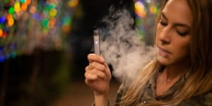 A girl smoking using a vaping device