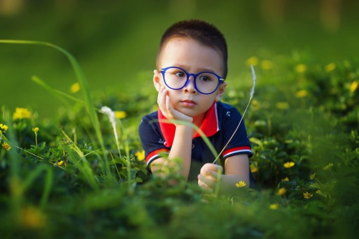 A picture of cute kid with glasses