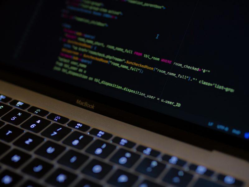 Code displayed on a MacBook