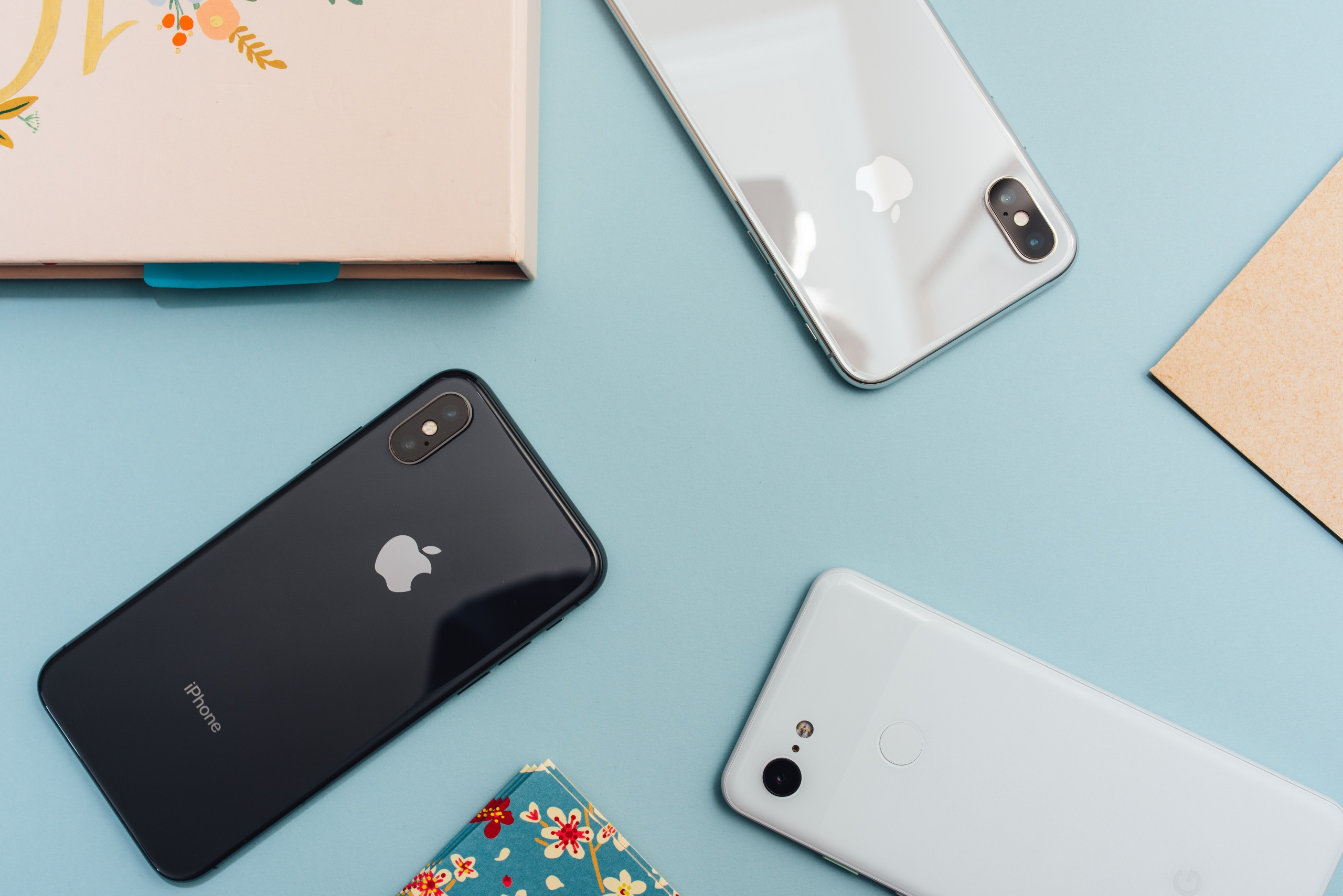 A photo of iPhone X, iPhone XS, and Pixel 3 XL cameras