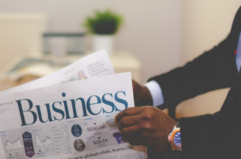 A photo of a businessman reading business newspaper