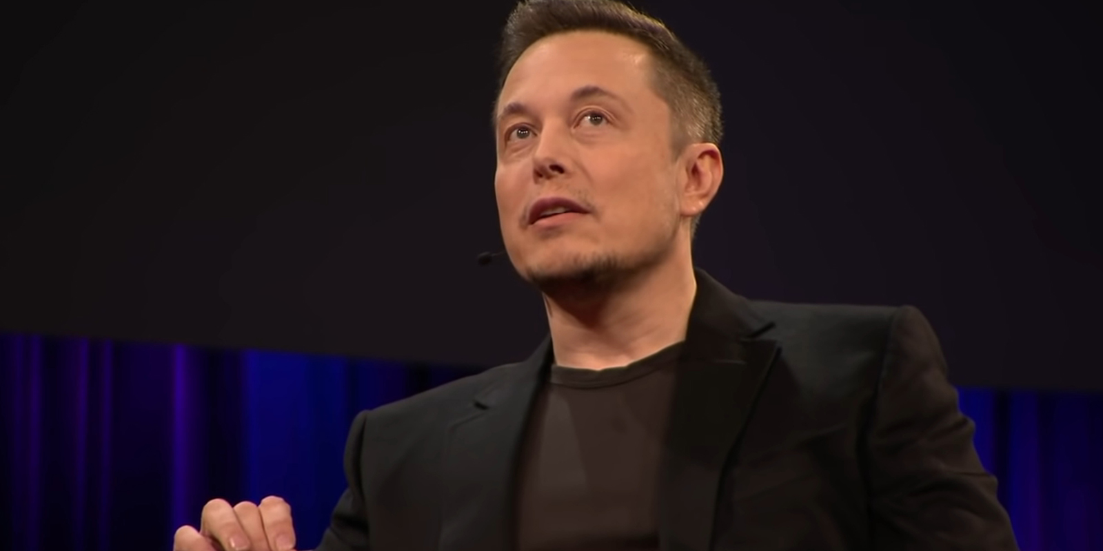 A picture of Elon Musk from a TED talk