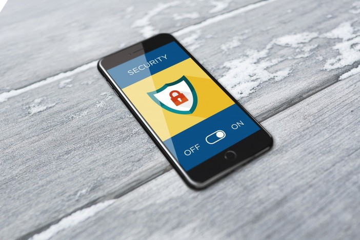A photo of a phone with security lock logo on the screen