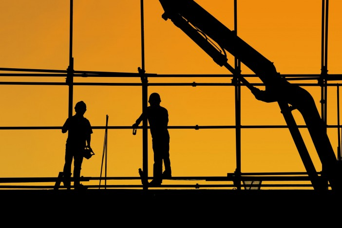 Photo of two labourers working at a construction site