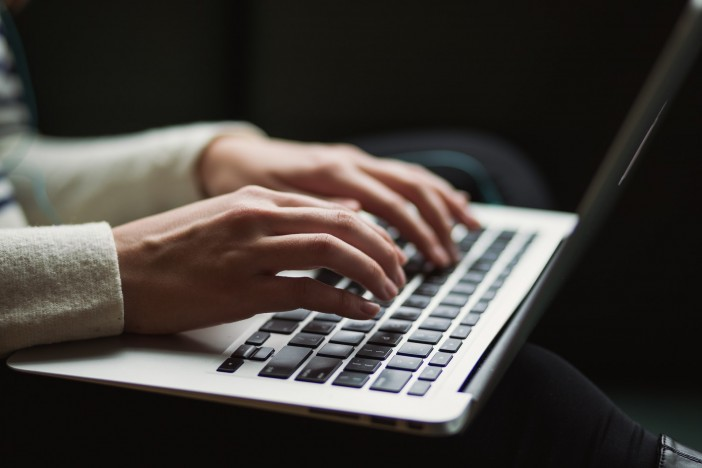 A person typing on a laptop