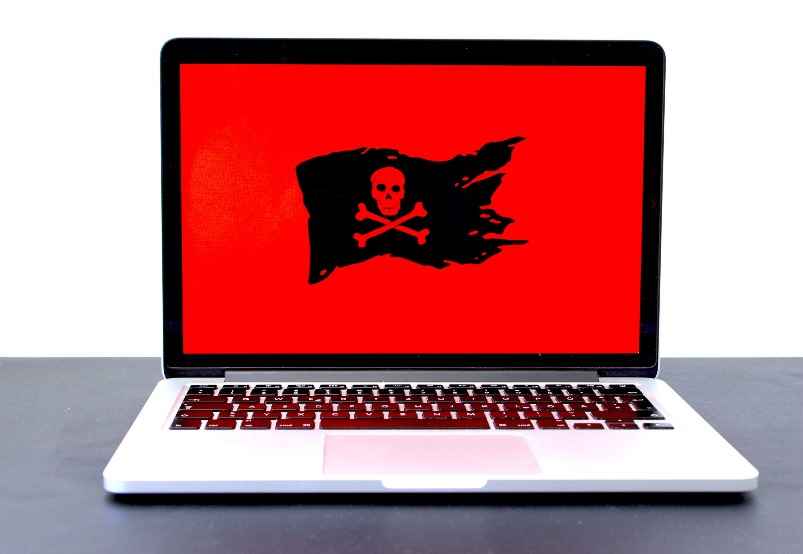 Photo of a laptop with pirate sign
