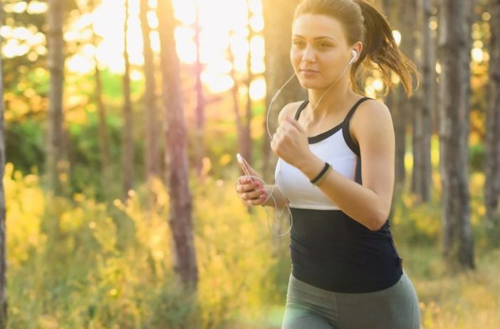 A girl listening to music while jogging