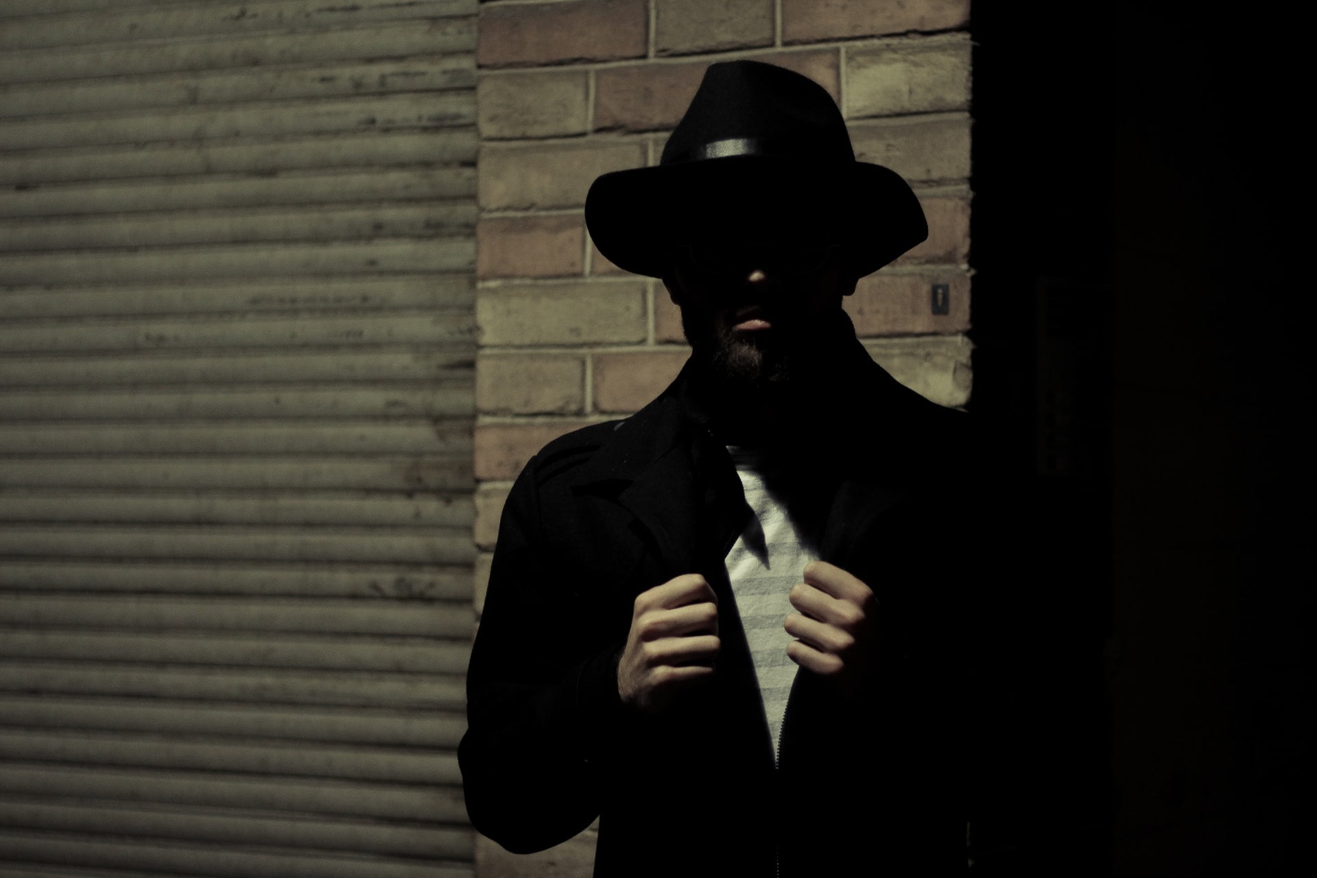 A person in dark wearing spy suit