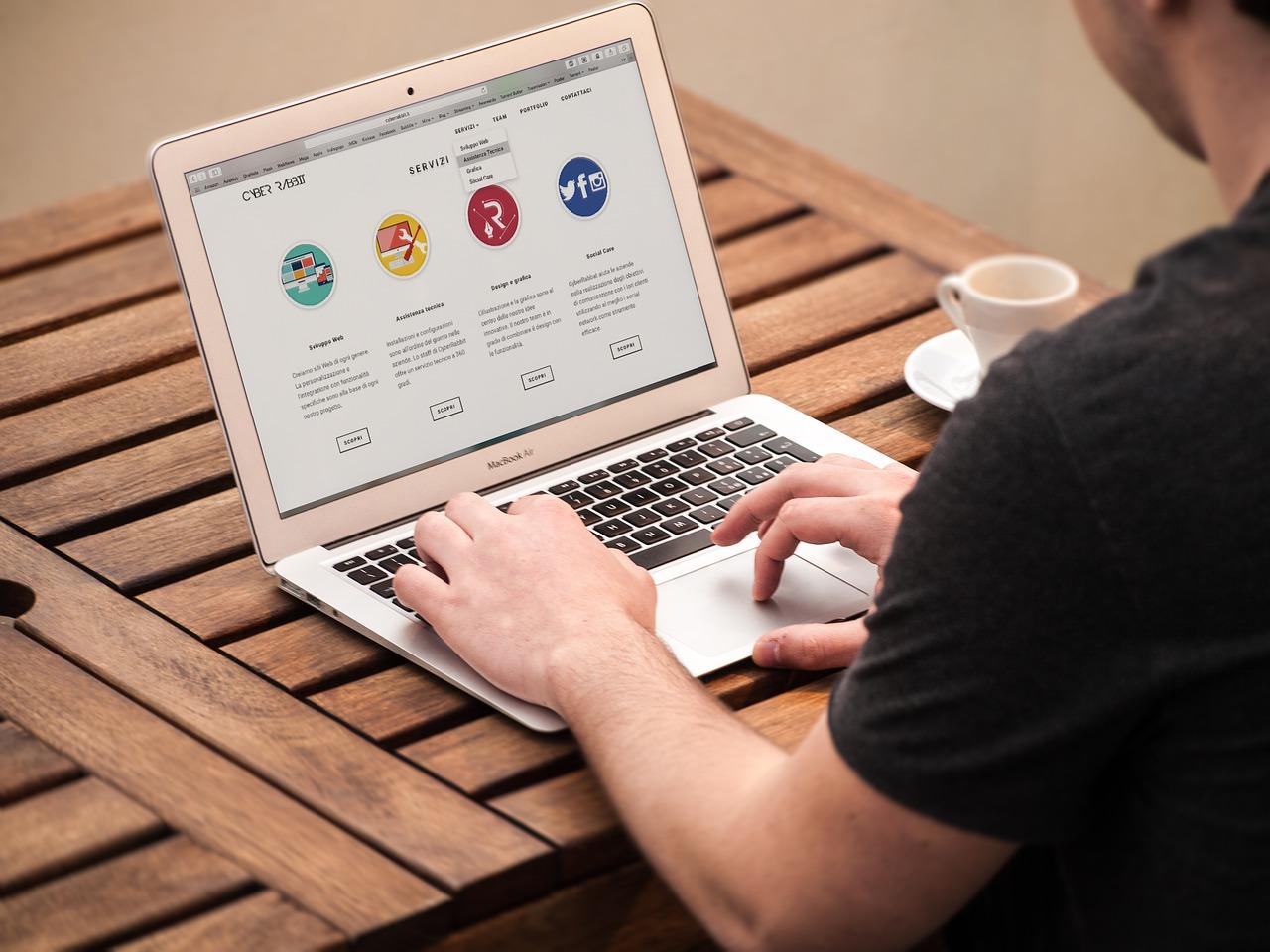 a-man-visiting-a-website-on-a-laptop