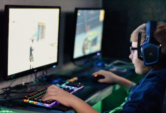 A kid playing video games on his computer
