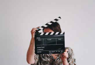 A woman holding movie roll
