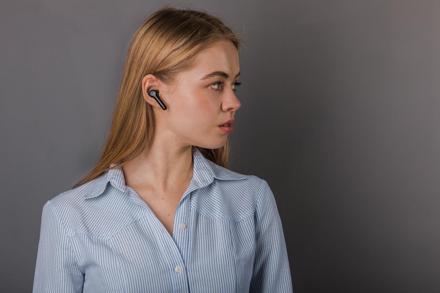 A girl wearing wireless headphones