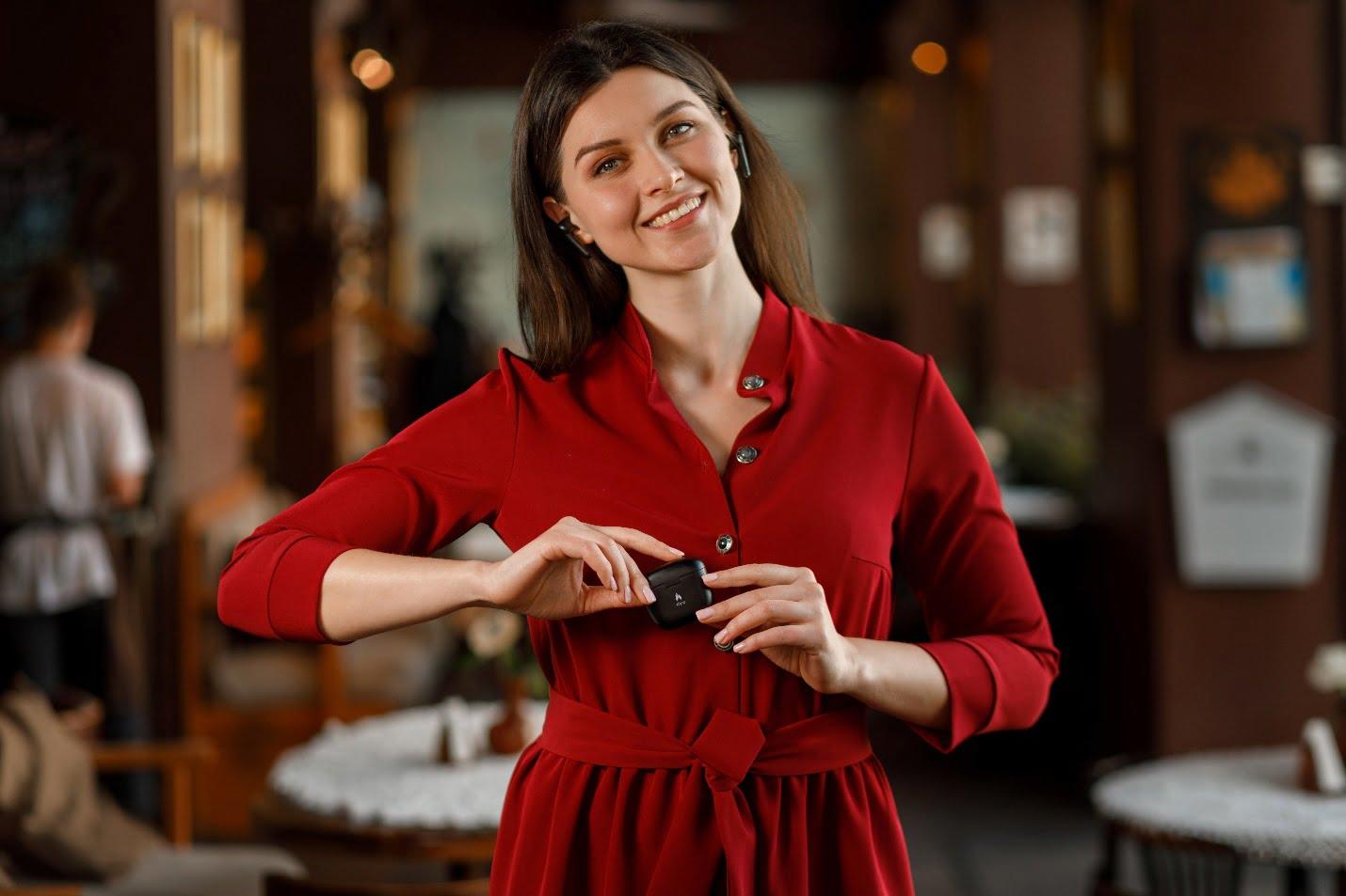 A girl holding earphones