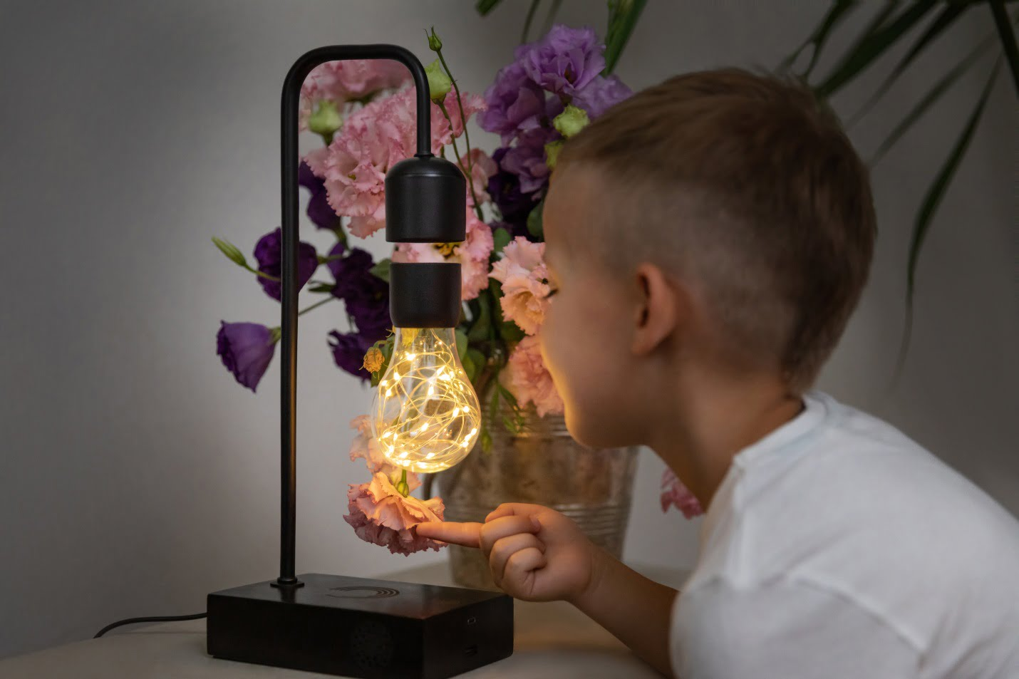 A kid playing with the bulb Gravita