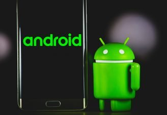 An Android dummy standing near an Android phone