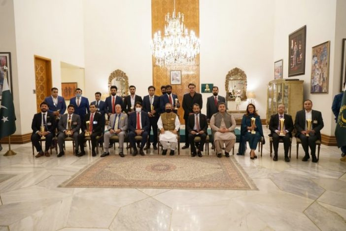 A group photo of Best Software House award winners with President of Pakistan, Arif Alvi at Awain-e-Sadar, Islamabad, Pakistan