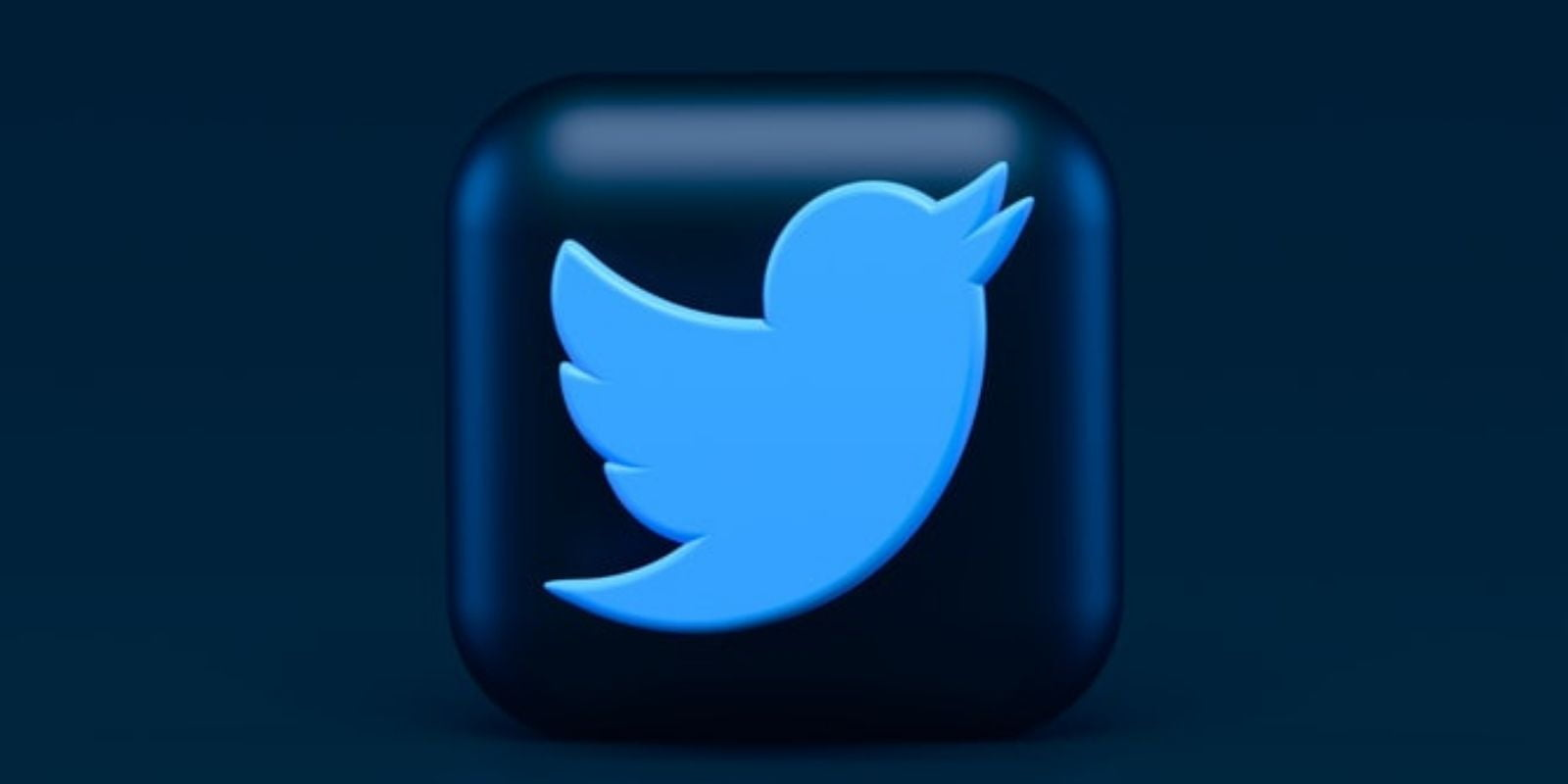 An icon of Twitter with dark blue squared background