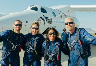 Richard branson cheering up with his crew in fron of Unity VSS rocket plane